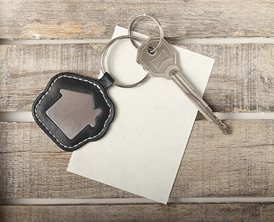 key for your new home lying on table