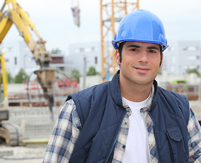 young self-employed worker with hard hat